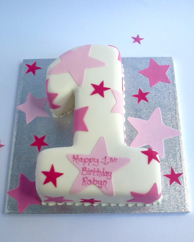 Soft Iced Number Cake Decorated With Contrasting Pink Cut Out Icing Stars You Can Also Add The Teddy Available In Standard Or Large Sizes