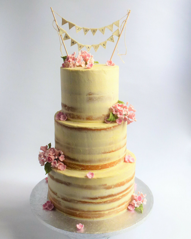 Semi-Naked Wedding Cake with pretty sugar posies | Karen\'s Cakes